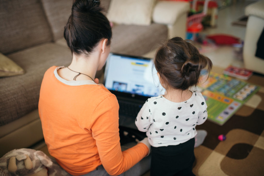 Mother and young daughter look at a laptop.  Photo credit: nenadstojkovic (Flickr)